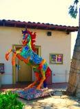 火热的被绘的马雕象 免版税库存图片