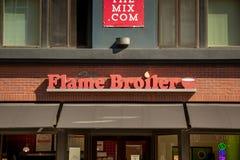 火焰烤焙用具餐馆标志 免版税库存图片