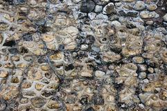 火石和石墙背景纹理 免版税库存图片