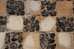 火石和砂岩棋子板墙壁建筑细节 免版税图库摄影