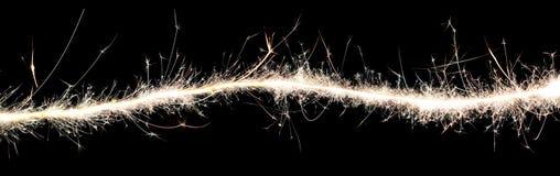 火花和轻的背景波浪  免版税图库摄影