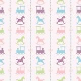 火车和五颜六色的婴孩摇马样式 库存图片