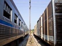 火车和卡车是平行的公园在平台 图库摄影