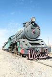 火车无盖货车在沙漠 库存图片