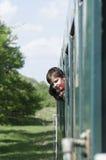 火车的愉快的孩子 库存图片