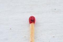 火柴梗和他的微笑 免版税库存图片