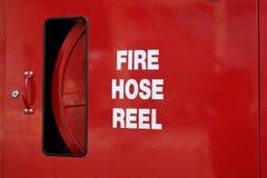 灭火水龙带卷轴 免版税库存图片