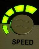 绿灯作为背景的速度按钮 免版税库存图片