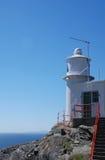 灯塔下海洋 库存照片