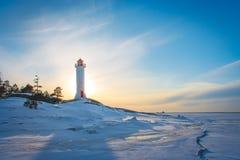 灯塔冬天波罗的海 免版税库存照片