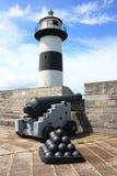 灯塔和大炮 免版税库存图片