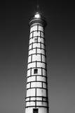 灯塔和太阳火光 免版税库存图片