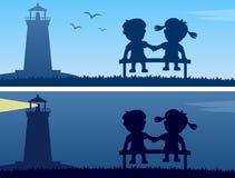 灯塔和孩子剪影 免版税库存图片