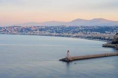 灯塔在日出的尼斯 免版税图库摄影