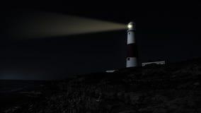 灯塔在晚上 库存图片