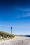 灯塔在有巨大天空形成的Skagen 免版税库存图片