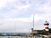 灯塔在港口 免版税库存图片
