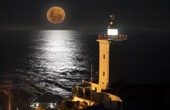 灯塔月亮 免版税库存图片