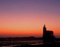 灯塔markermeer荷兰日出 免版税库存照片