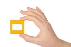 幻灯片的照片框架在手中 图库摄影