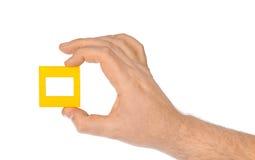 幻灯片的照片框架在手中 免版税库存照片