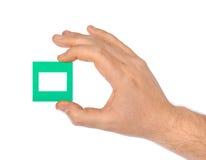 幻灯片的照片框架在手中 库存照片