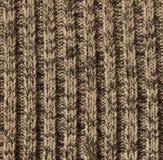 灰棕色作为背景的被编织的羊毛纹理 免版税图库摄影