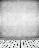 灰泥墙壁和木地板 免版税库存图片