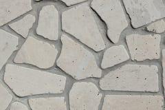 灰色优美的石墙 库存照片