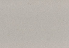 灰色包装纸纸板纹理,轻的质感粗糙的拷贝空间背景,灰色,褐色,棕褐色,黄色,灰棕色,水平 免版税图库摄影