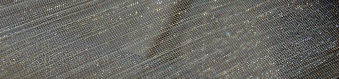 灰色发光的衣服饰物之小金属片纺织品背景 免版税库存照片