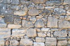 灰色古色古香的石砖墙纹理外部 免版税库存照片