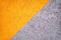灰色和橙色混凝土墙纹理 免版税库存图片