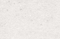 灰色回收了水平的便条纸纹理,轻的背景 库存照片