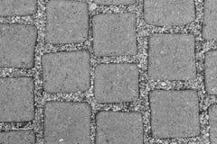 灰色块顶视图纹理在边路具体地面的  免版税图库摄影