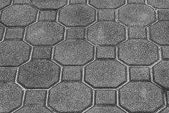 灰色块顶视图纹理在边路具体地面的  库存照片