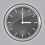 灰色壁钟在3时 库存图片