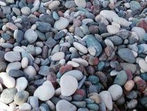 灰色小卵石的纹理在海滩的 免版税图库摄影