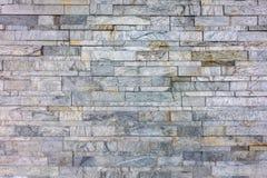 灰色岩石分层堆积墙壁纹理背景 免版税库存图片