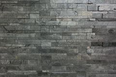 灰色岩石分层堆积纹理的墙壁 免版税图库摄影