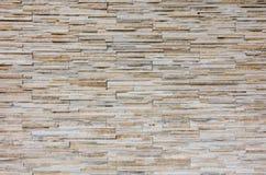 灰色岩石分层堆积纹理背景的墙壁 图库摄影