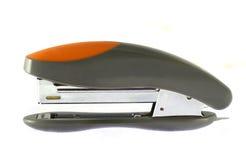 灰色查出的橙色stepler 免版税图库摄影