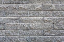 灰色概略的砖墙背景 免版税库存照片