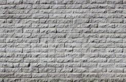 灰色混凝土瓦现代墙壁向模仿扔石头 库存照片
