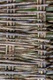 灰色湿纹理编织家具的老表面 葡萄酒的模糊的背景 免版税库存图片