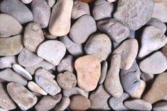 灰色环绕了异种结构,背景石头  库存照片