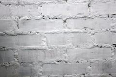灰色白的被绘的粗砺的砖墙 免版税库存照片
