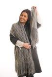 灰色的一个女孩编织了围巾微笑 免版税图库摄影