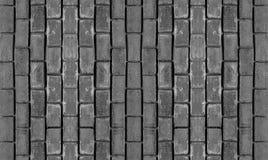 灰色石基础设计单色垂直的行对称长方形鹅卵石不尽的背景 免版税库存照片