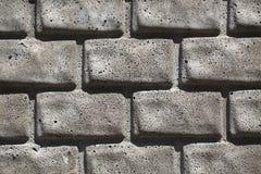 灰色砖墙背景。 免版税库存图片